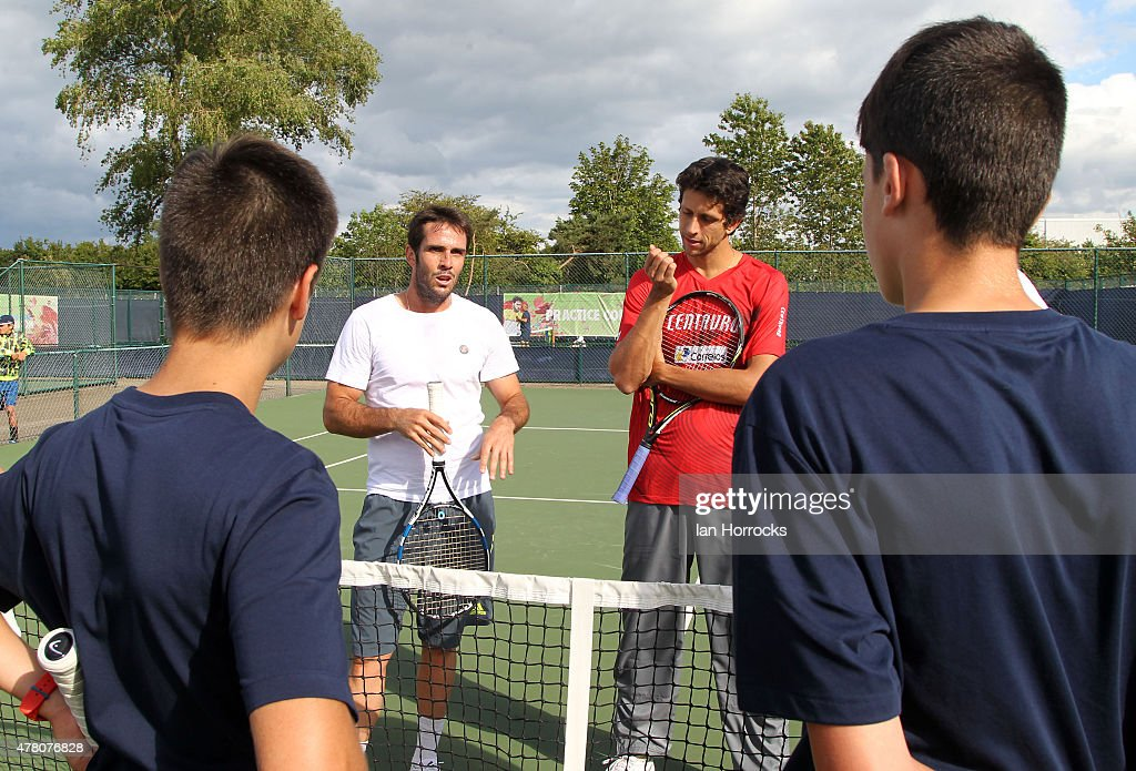 Young British players during a coaching session with Professional players <a gi-track='captionPersonalityLinkClicked' href=/galleries/search?phrase=David+Marrero&family=editorial&specificpeople=5357971 ng-click='$event.stopPropagation()'>David Marrero</a> of Spain (L) and <a gi-track='captionPersonalityLinkClicked' href=/galleries/search?phrase=Marcelo+Melo&family=editorial&specificpeople=4278628 ng-click='$event.stopPropagation()'>Marcelo Melo</a> of Brazil (R) during day one of the ATP Aegon Open at Nottingham Tennis Centre on June 21, 2015 in Nottingham, England.