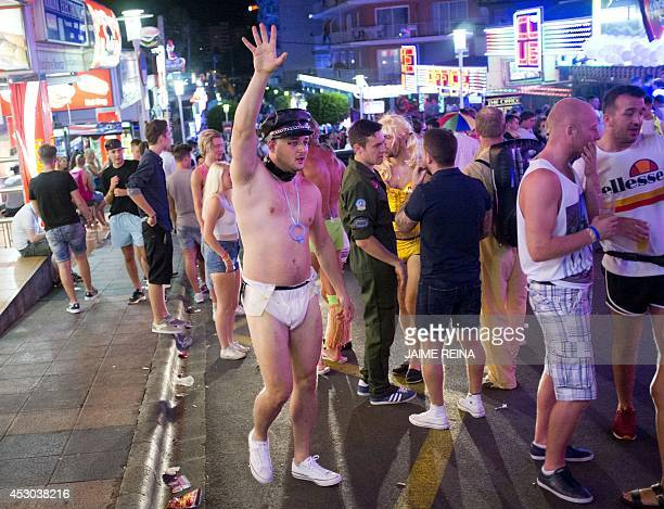A young British tourist gestures in Punta Ballena street as he has fun in the Magalluf zone in Calvia on Mallorca Island late on August 1 2014 The...