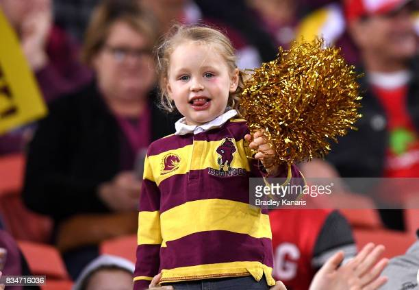 A young Broncos fan shows her support during the round 24 NRL match between the Brisbane Broncos and the St George Illawarra Dragons at Suncorp...