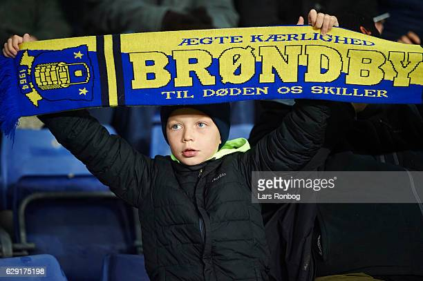 A young Brondby IF fan cheer with a scarf prior to the Danish Alka Superliga match between Brondby IF and FC Midtjylland at Brondby Stadion on...