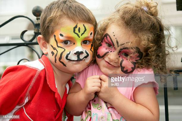 Young brother and sister face painting portrait