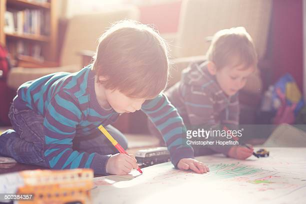 Young brothers drawing