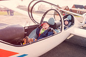 Young brothers in a glider