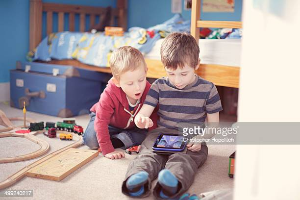 Young brothers playing with tablet computer