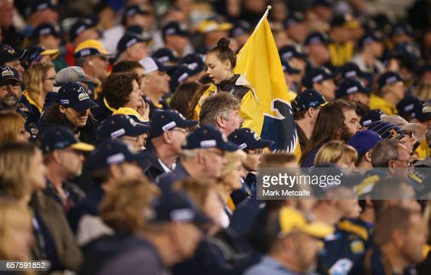 A young Brumbies fan with a flag walks through the crowd during the round five Super Rugby match between the Brumbies and the Highlanders at GIO...