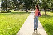 Young Brunette Female Walking in a Park