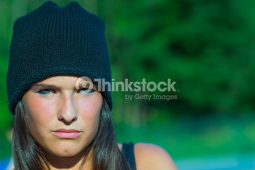 7587a4fc3943 Young brunette girl with woolen cap   Stock Photo