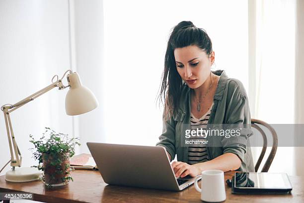 young brunette looking at laptop