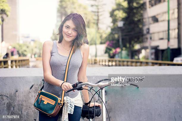 Young brunette with bicycle