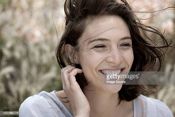 Young brunette woman alone outdoors, portrait