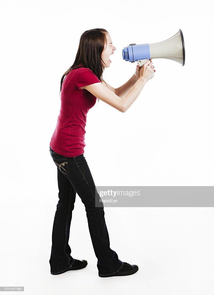 Young brunette yells energetically  into loud hailer
