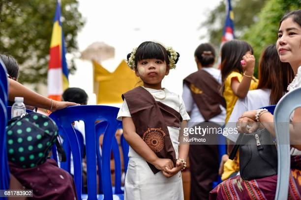 Young buddhist devotee girl pictured during Vesak day celebration in Kuala Lumpur Malaysia on May 10 2017 Vesak day on the fullmoon day of the sixth...