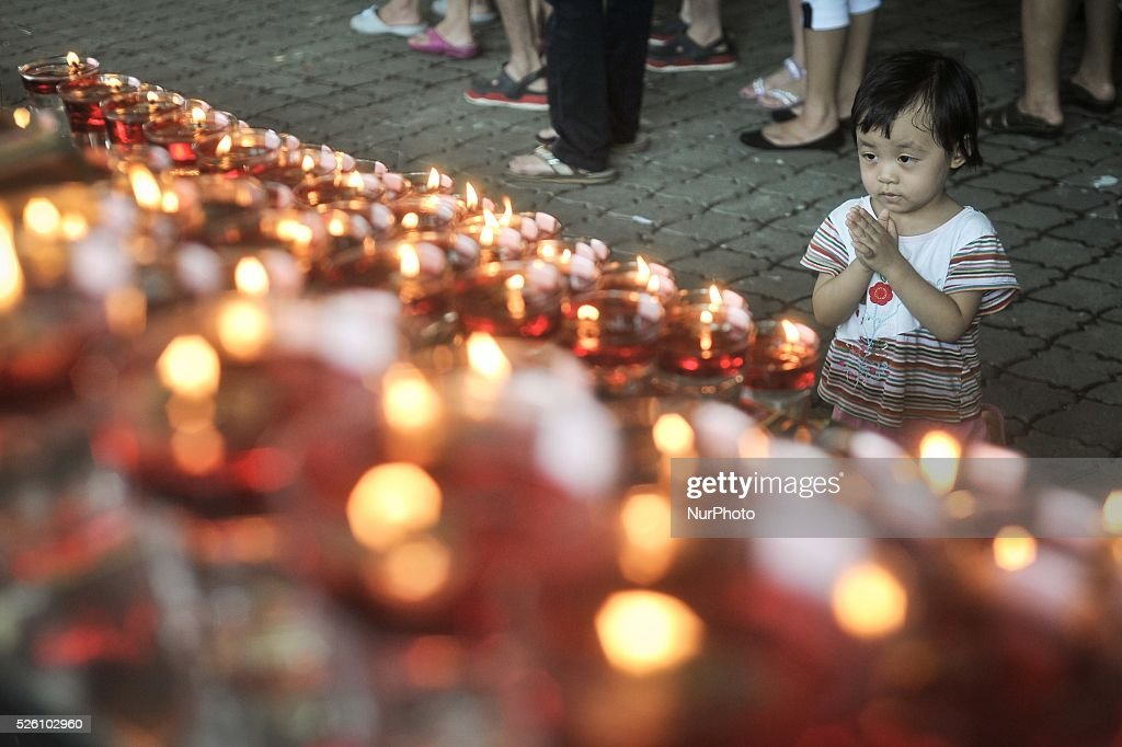 A young buddhist devotee offers prayers during Vesak Day celebrations at a Buddhist temple in Kuala Lumpur Malaysia on May 13 2014 Photo Mohd FIrdaus...