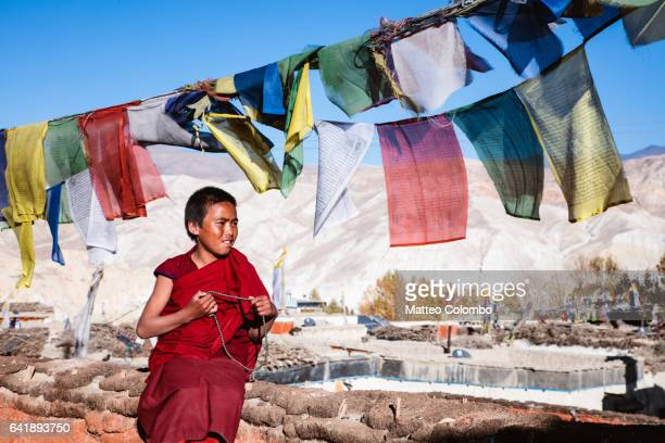 Young buddhist monk praying, Upper Mustang, Nepal