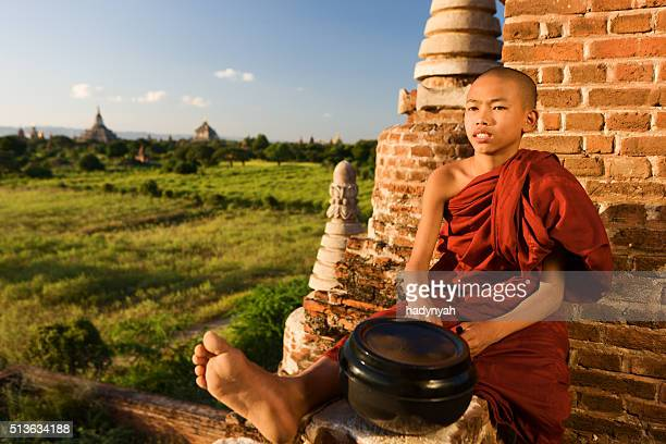 Young Buddhist monk resting on the temple, Bagan