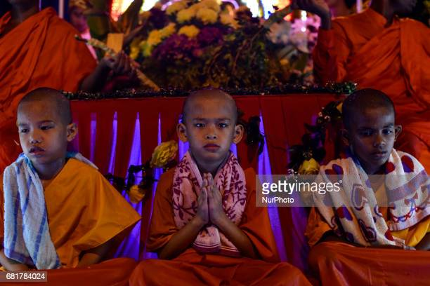 Young Buddhist monks and devotees take part in parade during Vesak day celebration in Kuala Lumpur Malaysia on May 10 2017 Vesak day on the fullmoon...