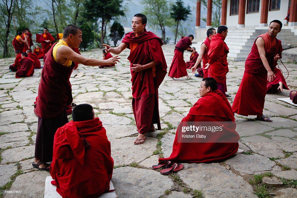 CONTENT] Young buddhist monks at a monastery in Bumthang, central Bhutan, debate what they have learned during their monastic studies. This unique arguing technique develops their logical reasoning, where the standing debater tries to undermine the logic of the seated defender, or come up with a new argument.