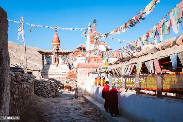 Young buddhist monks in a village, Upper Mustang, Nepal