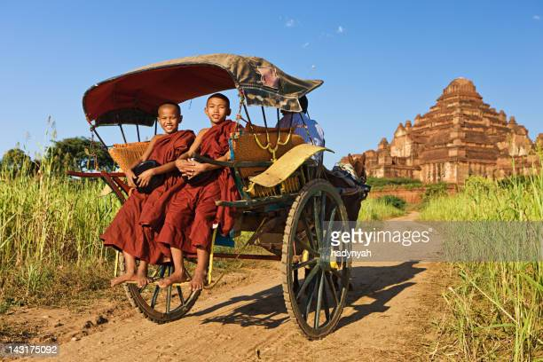 Young Buddhist monks on the horse cart