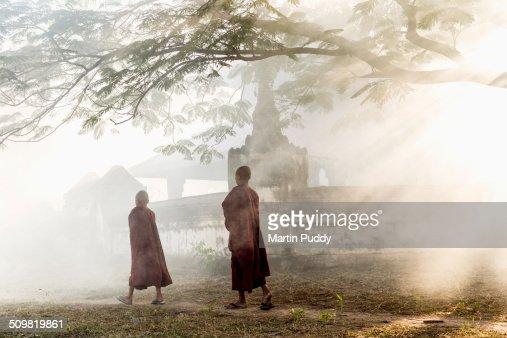 young Buddhist monks walking along path