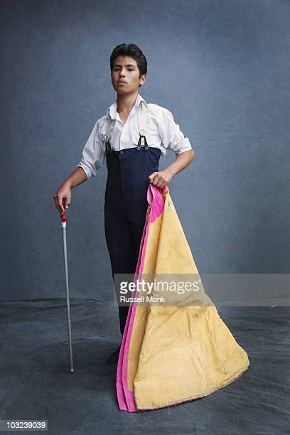 Young bullfighter with his cape