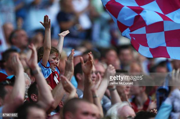 A young Burnley fan cheers during the CocaCola Championship Playoff Final between Burnley and Sheffield United at Wembley Stadium on May 25 2009 in...