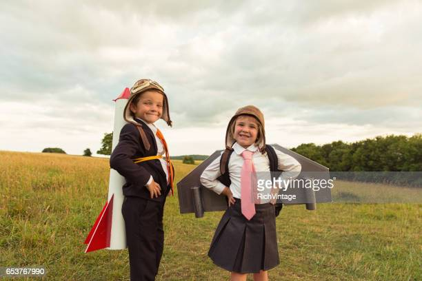 Young Business Boy and Girl with Rocket and Jet Pack