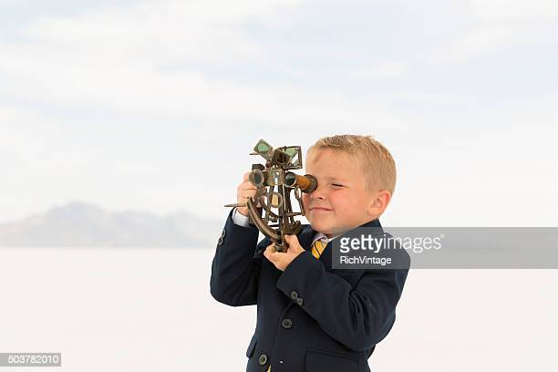 Young Business Boy Looking Through Sextant