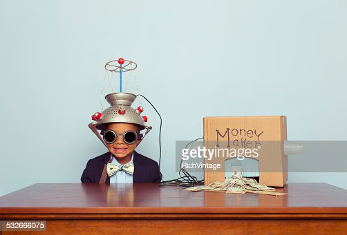 Young Business Boy wearing Mind Reading Helmet Makes Money