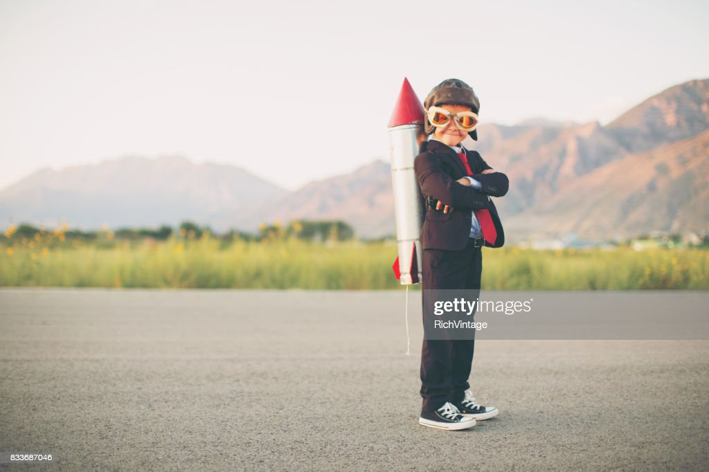 Young Business Boy with Rocket on Back : Stock Photo