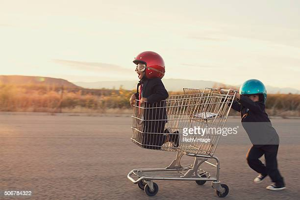 Young Business Boys Race in Shopping Cart