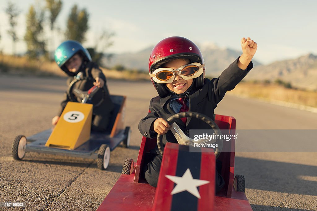 Young Business Boys Race Toy Cars : Stock Photo