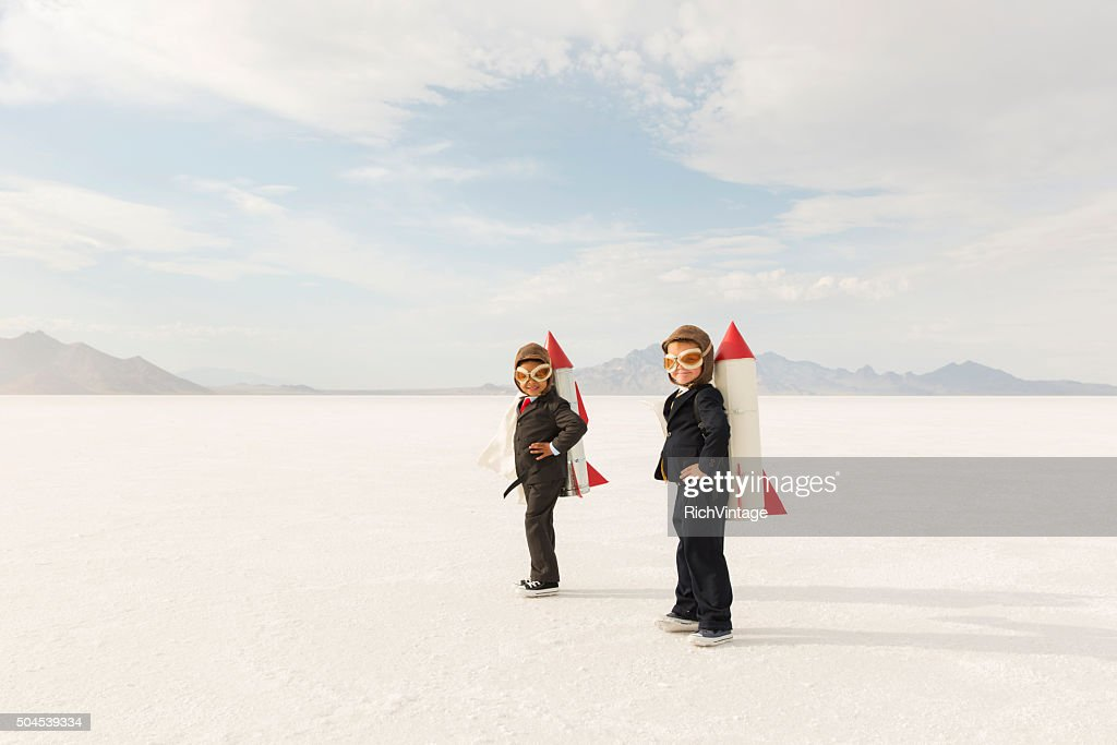 Young Business Boys Wearing Rockets : Stock Photo