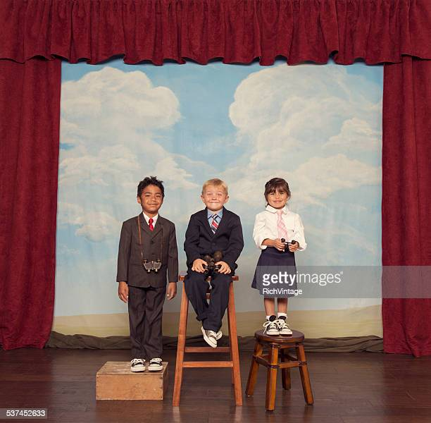 Young Business Children on Stage with Bionoculars