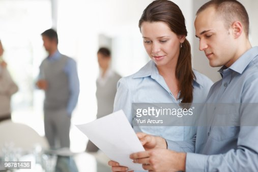 Young business colleagues discussing : Stock Photo