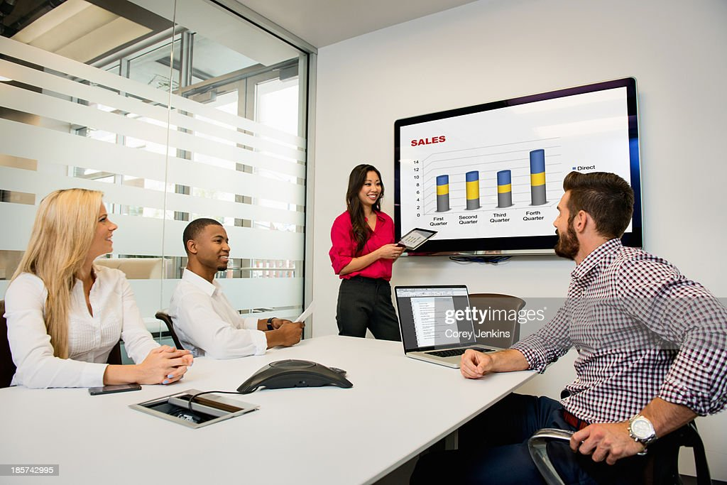 Young business colleagues looking at digital table in meeting in conference room : Stock Photo