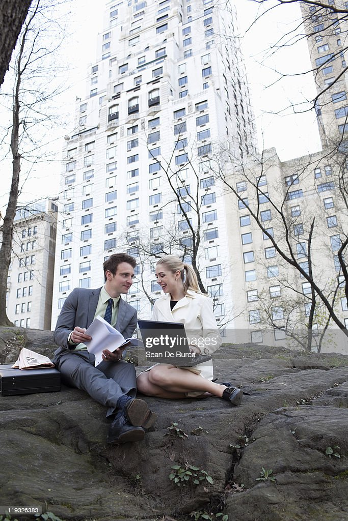 Young business couple in Central Park. : Stock Photo