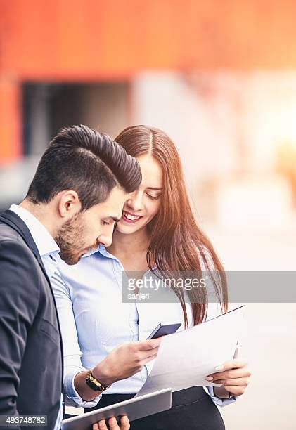 Young business couple outdoors