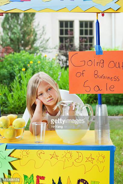 Young Business Entrepreneur with Recession Failing Lemonade Stand Vt