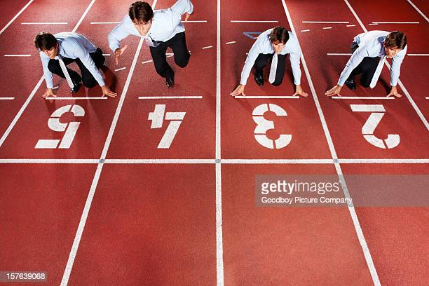 Young business executive at starting line of race