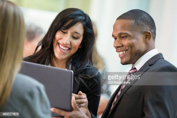 Young business executive discussing company growth with digital tablet