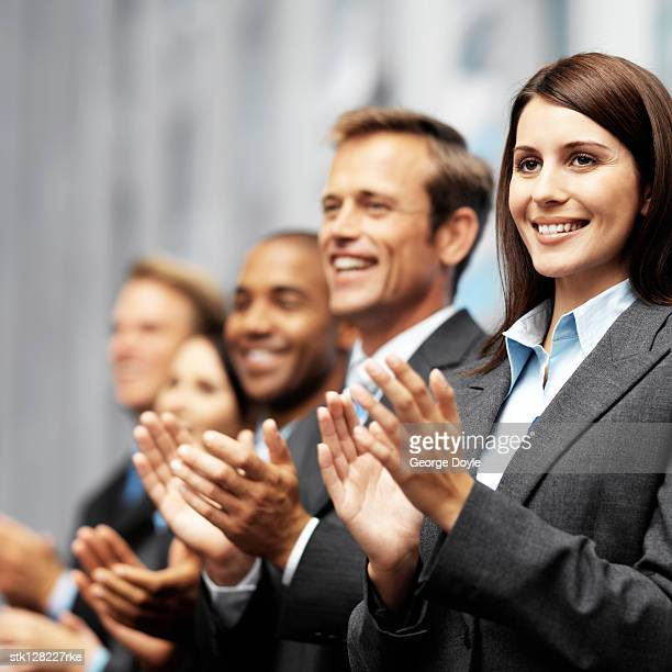 young business executives clapping
