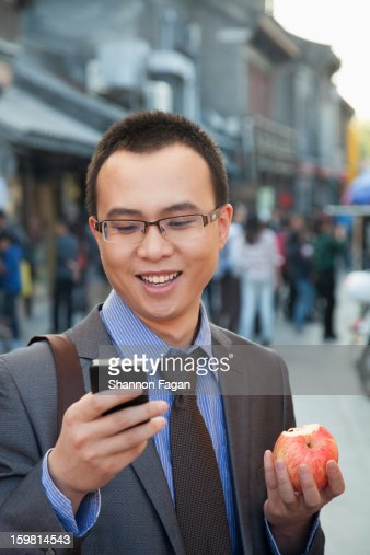 Young Business Man checking Cell Phone in Houhai : Stock Photo