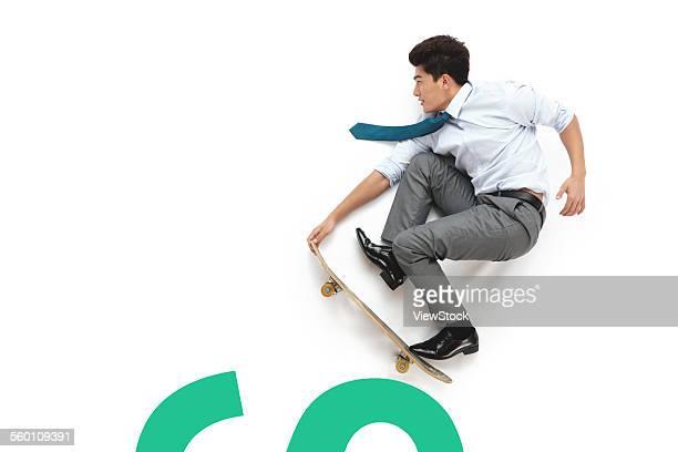 A young business man do skateboarding