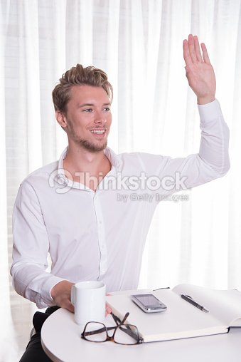 Young business man greeting someone stock photo thinkstock young business man greeting someone stock photo m4hsunfo