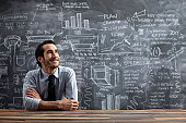 young business man in front of chalkboard