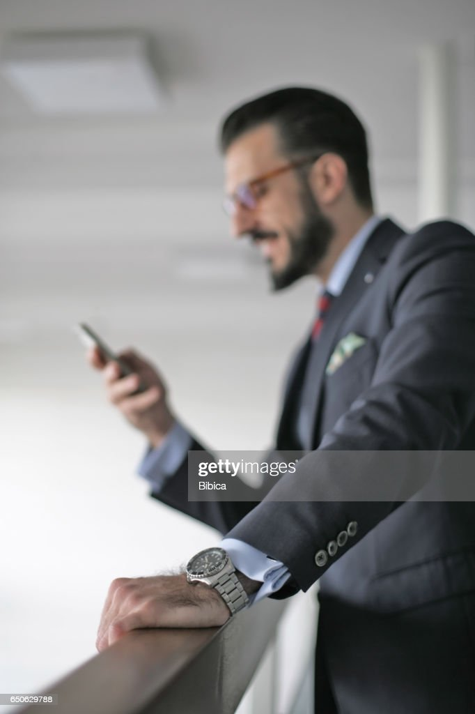 Young business man on the phone : Stock-Foto