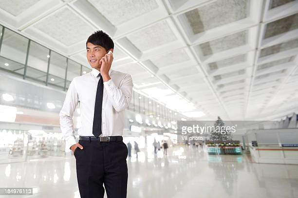 Young business man using cellphone