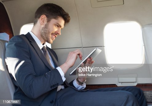 Young Business Man Using Graphics Tablet On Plane