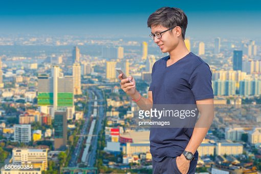 Young business man using laptop and digital tablet cityscape background : Bildbanksbilder